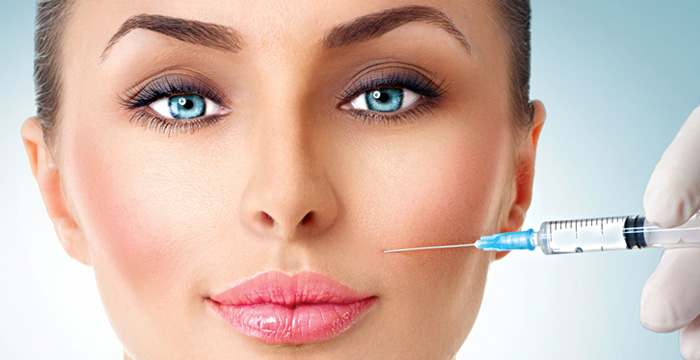 Injectable & Fillers - Syringe on Female Face